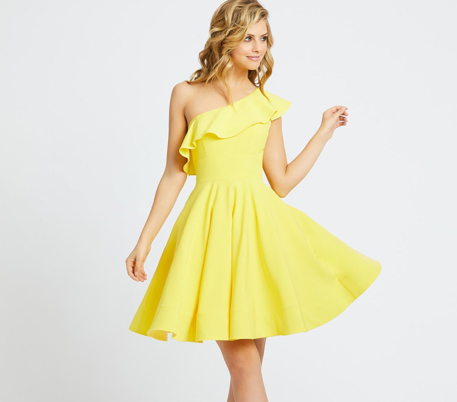 Model in yellow Mac Duggal dresses