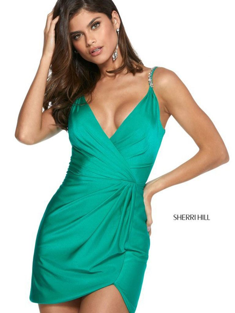 Model in green Sherri Hill dress